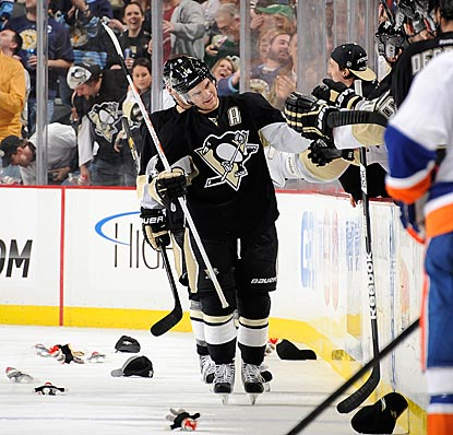 Amid a littering of sock monkeys, Chris Kunitz accepts congratulations upon completion of his second hat trick of the season.  (Getty Images)
