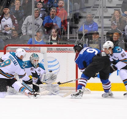 Matt Duchene (9) fires the winning goal past San Jose's Antti Niemi (31) an instant before time expires in overtime.  (USATSI)