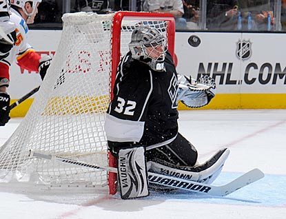 Jonathan Quick makes this save and 22 others to help the Kings earn their 11th victory in their past 14 games.  (Getty Images)