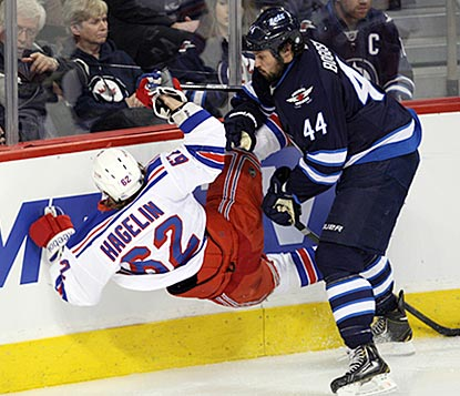 Zach Bogosian knocks Carl Hagelin off his feet, and the Jets knock the Rangers out of the playoff picture.  (USATSI)