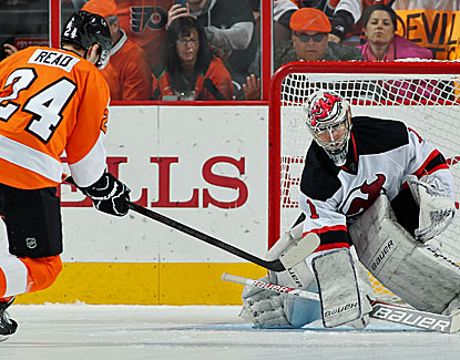 Philly's Matt Read scores a shoot-out goal against New Jersey's Johan Hedberg in the Flyers' win. (USATSI)
