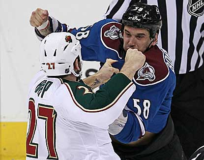 Colorado's Patrick Bordeleau and Minnesota's Mike Rupp square off during a chippy first period that features four Wild goals. (USATSI)