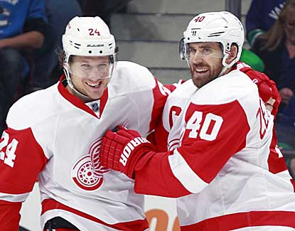 Detroit's Henrik Zetterberg, right, scores two goals, his first in 11 games, in the Wings' 5-2 win over Vancouver. (Getty Images)