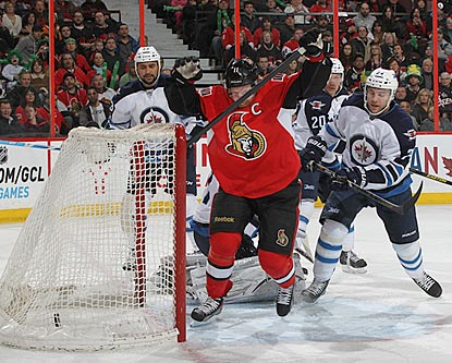 Ottawa's Daniel Alfredsson celebrates after putting the puck past Winnipeg's Guillaume Latendresse to open the scoring.  (Getty Images)