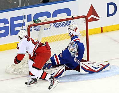 Rangers goalie Henrik Lundqvist makes 29 saves and two stops in the shootout as New York edges Carolina.  (USATSI)