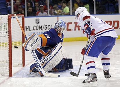 Brian Gionta scores past New York's Kevin Poulin early in the third period to put the Canadiens ahead for good.  (AP)