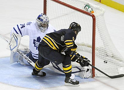 Buffalo center Steve Ott scores the deciding goal against Toronto's James Reimer in the sixth round of the shootout.  (AP)