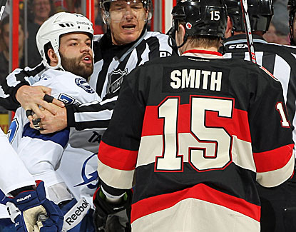 Tampa Bay's Radko Gudas has words with Ottawa's Zack Smith. The Lightning can not recover from an early deficit. (Getty Images)