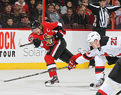 Sens captain Daniel Alfredsson fires a shot on goal in a 3-2 win over the Devils. (Getty Images)
