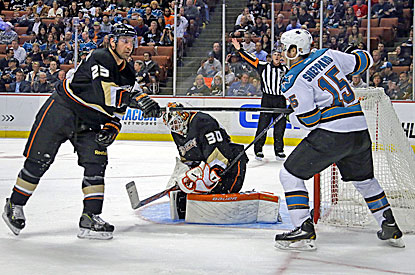 Anaheim's Brad Staubitz (left) gets into a shoving match with San Jose's James Sheppard during the first period.  (AP)