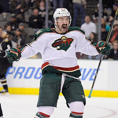 Cal Clutterbuck celebrates Kyle Brodziak's goal during a rare Wild victory in the home of the former Minnesota team.  (USATSI)