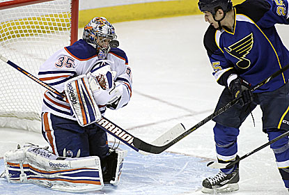 Nikolai Khabibulin turns away one of the 43 shots as the Oilers win at St. Louis for the first time since 2009. (AP)