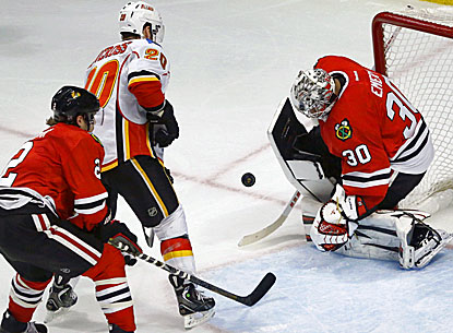 Ray Emery makes one of his 16 saves against the Flames in the Blackhawks' 2-0 win. (AP)