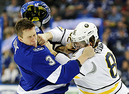 Tampa Bay's Keith Aulie (left) takes a punch from Buffalo's Marcus Foligno during the Lightning's 2-1 win. (AP)