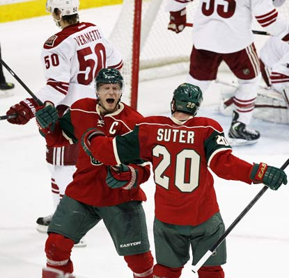 Mikko Koivu (left) scores with 2:43 left in overtime to cap a comeback and send the Wild to their seventh straight win.  (AP)