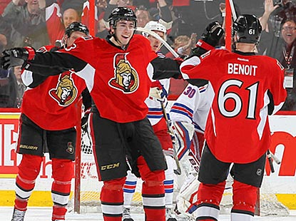 Andre Benoit receives congratulations from Mika Zibanejad after opening the scoring in the second period.  (Getty Images)