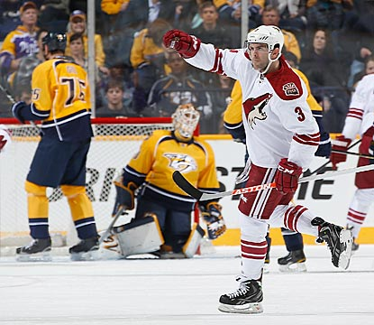 Keith Yandle gestures after putting a shot past Nashville's Chris Mason for one of Phoenix's six goals in the opening period.  (Getty Images)