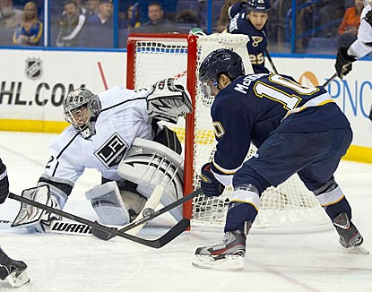 Los Angeles goalie Jonathan Quick denies St. Louis left wing Andy McDonald during the second period.  (USATSI)