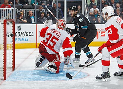Brent Burns wrists a shot past Jimmy Howard to increase San Jose's lead to 2-0 early in the third period.  (Getty Images)