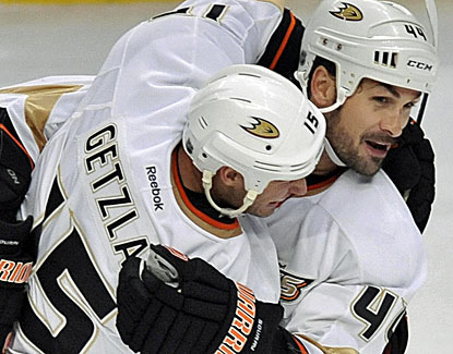 Anaheim's Sheldon Souray, right, scores the go-ahead goal with 2:08 left in the Ducks' win over the Blackhawks. (AP)