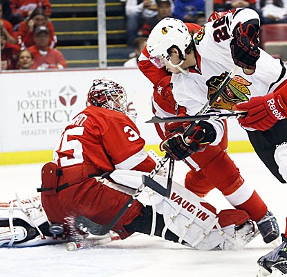 Jeremy Morin (26) gets past Red Wings goalie Jimmy Howard to score in the first period.  (AP)