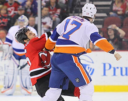 Islanders left wing Matt Martin knocks out Devils right wing Tom Kostopoulos during their fight in the first period.  (Getty Images)