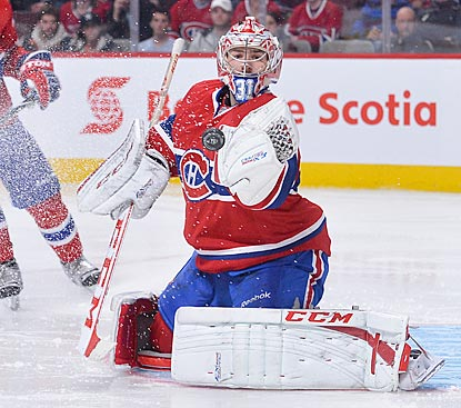 Carey Price makes 18 saves en route to his third consecutive victory, and his eighth in his past 11 games.  (Getty Images)