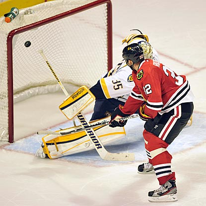Michal Rozsival beats Pekka Rinne in the fifth round of the shootout, and Chicago improves to 11-0 against divisional foes.  (AP)