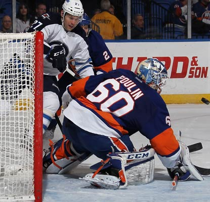 Islanders goalie Kevin Poulin gets his first win of the season with a 23-save performance.  (Getty Images)