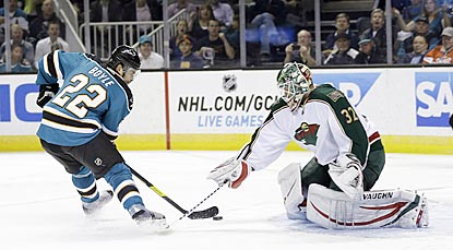 Dan Boyle completes an end-to-end rush with a backhand shot past Minnesota's Niklas Backstrom in the first period.  (AP)