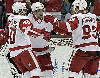 Pavel Datsyuk knocks in a rebound at 4:45 of overtime, giving the Red Wings a needed victory. (AP)