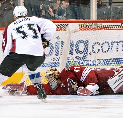 Coyotes goalie Mike Smith makes a diving save against the Avalanche in his fifth shutout of the season.  (Getty Images)