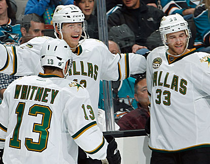 Dallas' Alex Chiasson (middle) celebrates one of his two goals against the Sharks with his Stars' teammates. (Getty Images)