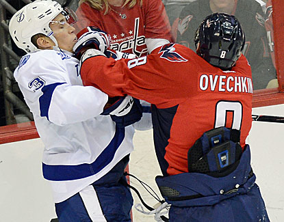 Washington's Alex Ovechkin mixes it up with Tampa Bay's Keith Aulie. Ovechkin scores two goals in the Capitals' win. (Getty Images)