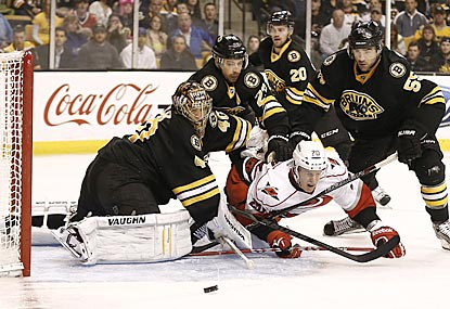 Boston's Tuukka Rask gets some help from his friends in making sure Riley Nash (bottom) doesn't score in the first period.  (USATSI)