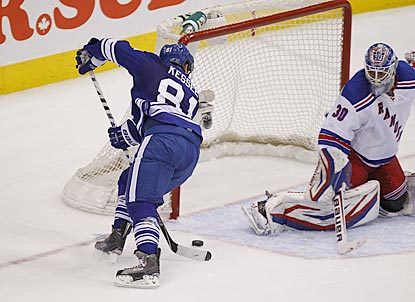 Seconds after New York ties the game, Phil Kessel converts his own rebound to put Toronto ahead to stay.  (USATSI)
