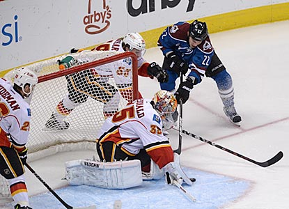 Calgary goalie Joey MacDonald makes 39 saves, including this denial of Matt Hunwick in the opening period.  (USATSI)
