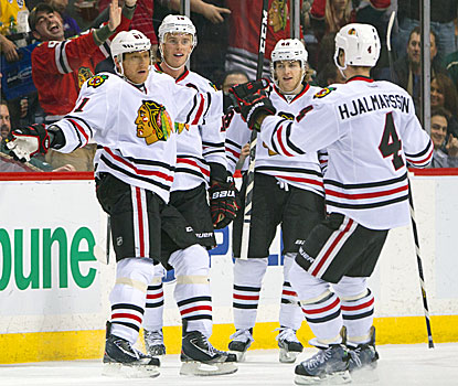 Marian Hossa (left) celebrates after scoring an unassisted goal in the second period, which proved to be the difference. (USATSI)