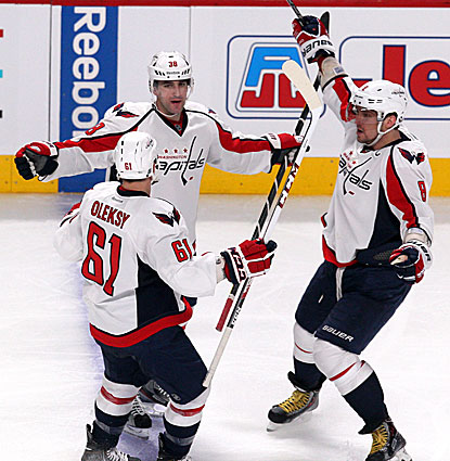 Jack Hillen (center) celebrates his goal against the Canadiens with Steve Oleksy and Alex Ovechkin (right). (USATSI)
