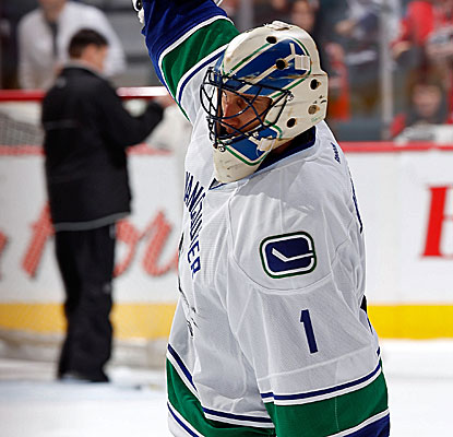 Vancouver goalie Roberto Luongo, in a surprise start, makes 40 saves, helping the Canucks take down the Flames. (Getty Images)