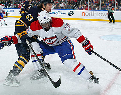 P.K. Subban battles Buffalo's Tyler Ennis for the puck. Subban scores one of Montreal's five goals in the game. (Getty Images)