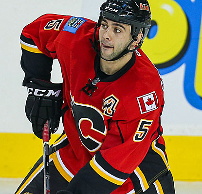 Calgary's Mark Giordano scores the winning goal 4:36 into overtime to send the Flames past the Coyotes. (Getty Images)
