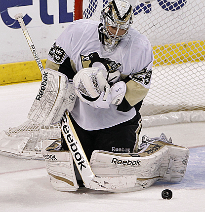 Penguins goalie Marc-Andre Fleury makes a save in the third period as Pittsburgh goes on to win.  (USATSI)
