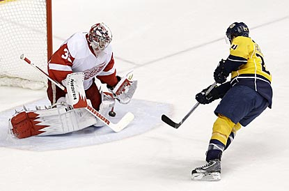 Detroit goalie Jimmy Howard denies Matt Halischuk in the second period en route to his second shutout of Nashville this season. (AP)