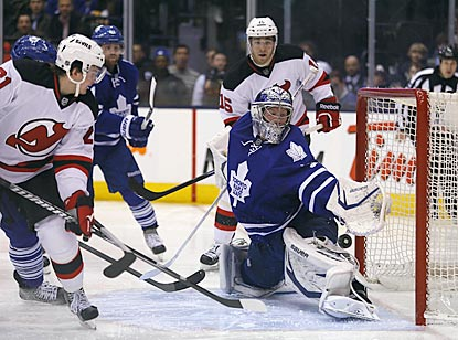 Maple Leafs goaltender James Reimer makes a save on Devils forward Andrei Loktionov during the second period.  (USATSI)