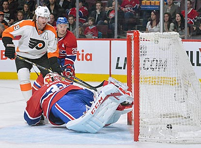 Scott Hartnell (top left) watches one of his two second-period goals get past Canadiens goaltender Carey Price.  (Getty Images)