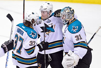 San Jose's Adam Burish (37) and Matt Irwin congratulate Antti Niemi (31) on his fourth shutout of the season.  (USATSI)