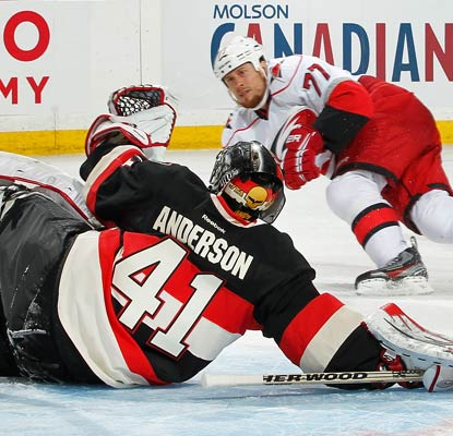Craig Anderson frustrates the Hurricanes all night, making a save here against Joe Corvo.  (Getty Images)