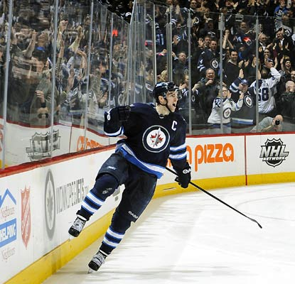 Andrew Ladd comes up huge for the Jets with two goals in regulation and the winner in the shootout.  (Getty Images)