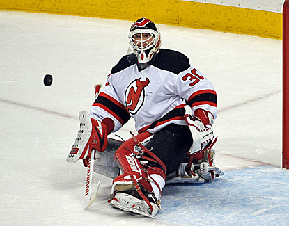 Devils' goalie Martin Brodeur is clutch, stopping 23 shots for his 121st career shutout in New Jersey's win. (USATSI)